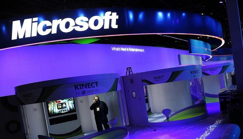 A man speaks on a cell at the Microsoft display during set up before the opening of the 2011 International Consumer Electronics Show January 5, 2011 in Las Vegas, Nevada. CES, the world's largest annual consumer technology tradeshow, officially runs from January 6-9. AFP PHOTO / Robyn Beck (Photo credit should read ROBYN BECK/AFP/Getty Images)