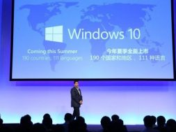 Terry-on-stage-in-front-of-Win10-LOGO-1-611×360.jpg