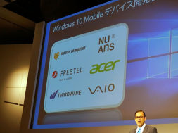 Microsoft-Japan-president-Takuya-Hirano-stands-in-front-of-a-slide-showing-the-logos-belonging-to-some-producers-of-Windows-10-Mobile-handsets